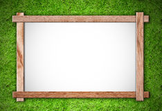 Wood frame on grass background Stock Images