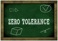 Wood frame green chalkboard with ZERO TOLERANCE message handwritten in chalk. Royalty Free Stock Photos