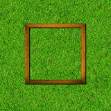 Wood frame on green grass field Royalty Free Stock Image
