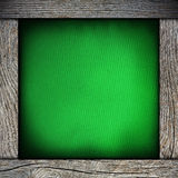 Wood frame with green paper Royalty Free Stock Photography