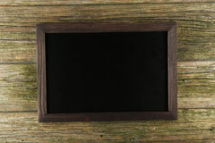 Wood frame on green wooden background stock images