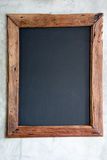 Wood frame on grunge wall Royalty Free Stock Photo