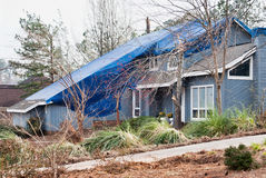 Wood Frame House with Tarpaulin Covering Roof After a Tornado Stock Image