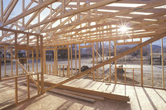 Wood frame of house under construction Stock Images