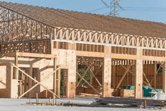 Wooden commercial building construction. Wood frame house under construction with foundation in Humble, Texas, USA. New stick built framing one floor commercial royalty free stock photos
