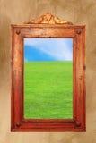Wood frame with idyllic scene on wall Royalty Free Stock Image