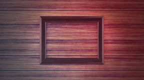 Wood frame on paneling. A background of wooden paneling with a wood frame Stock Photo