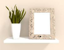 Wood frame on shelf. A decorated photo wood frame with plant on shelf for interior decoration Stock Photos