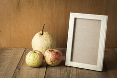 Wood frame with space and sear fruit. Photo stock images