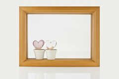 Wood frame and two heart on white background Stock Image