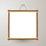 Wood frame white board with rope hanging on a nail Royalty Free Stock Image