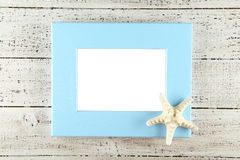 Wood frame on white wooden background. royalty free stock photos