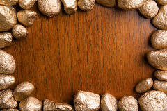 Wood framed by golden nuggets Stock Photo