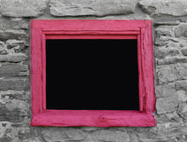 Wood framed opening in stone wall. Royalty Free Stock Photography
