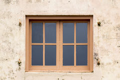 Wood framed windows on plaster wall Royalty Free Stock Photography