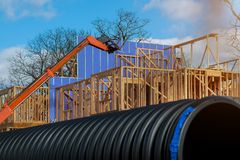 Wood framing on a new house under construction. Wood framing on a new house under framed new construction beam unfinished home structure industry build sky royalty free stock photo
