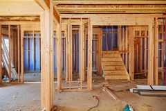 Wood framing work in progress with wood framing walls and ceiling or floor joist on new construction building. Wood framing work in progress with wood framing Royalty Free Stock Images
