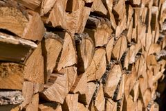 Wood Fuel. Pile of wooden logs as fuel for heating royalty free stock photos