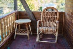 Wood furniture in rustic veranda Stock Photos