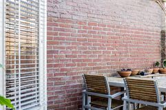 Wood garden table with brick wall stock photography