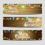 Wood with garlands Merry Christmas banners. Merry christmas horizontal banners template on wood backdrop with garlands. Vector illustration Stock Photos