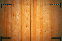 Wood gate. Wood fortress with metal hinges Stock Photos