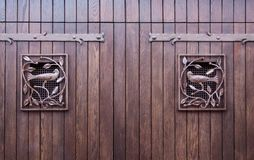 Wood gate with iron birds Stock Images
