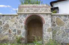 Wood gate and stone wall Royalty Free Stock Image