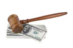 Wood gavel over some bank notes Royalty Free Stock Photo