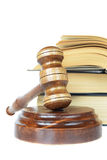 Wood gavel, soundblock and stack of thick old books Royalty Free Stock Photography