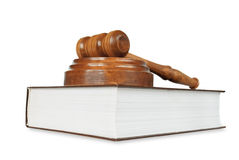 Wood gavel and soundblock on on a thick book Stock Images