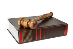Wood gavel and soundblock on on a thick book Stock Image