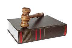 Wood gavel and soundblock on on a thick book Royalty Free Stock Photo
