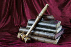 Wood gavel and stack of old books Stock Photography