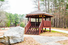 Wood Gazebo by Granite Boulder Royalty Free Stock Photography