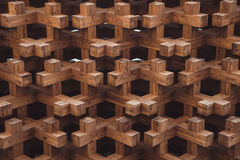 Wood geometrical pattern and dark background. Wood geometrical pattern with dark background Royalty Free Stock Images