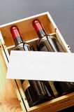 Wood gift box with two wine bottles. And blank card (vertical Stock Photography