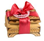 Wood gift casket with bow. Gift casket with red bow, on the white background Stock Image