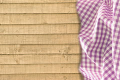 Wood and gingham background. Photo of wooden planks background with purple gingham check fabric ideal for own text etc Royalty Free Stock Photo