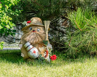 Wood goblin sitting under the tree waiting new year. Royalty Free Stock Images