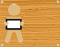 Wood Grain Carpentry Tablet PC Pad Illustration. A wooden sculptured puppet with a tablet PC being screwed to a wood plank Stock Image