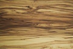 Wood-grain do marrom escuro em uma parede Fotografia de Stock Royalty Free