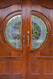 Wood grain door covers the stained glass. Pillar entrance of a house royalty free stock photo