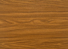 Wood grain surface. A full frame brown wood grain surface Royalty Free Stock Photo