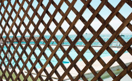 Wood grating. Wood grating with the sea view Royalty Free Stock Image