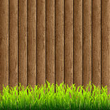Wood with green grass Stock Photos