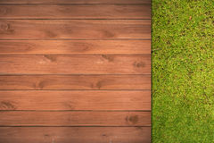 Wood with on the green grass background. Wooden with green grass background Royalty Free Stock Photography