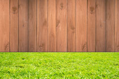 Wood with on the green grass background. Wooden with green grass background Royalty Free Stock Images
