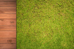 Wood with on the green grass background. Wooden with green grass background Royalty Free Stock Photos
