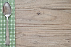 Wood and green plaid with spoon royalty free stock image